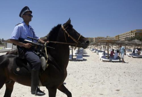 A Tunisian police officer on horse patrol the beach in front of the Imperial Marhaba Hotel in Sousse, Tunisia, Sunday, June 28, 2015. Tunisia's top security official says 1,000 extra police are being deployed at tourist sites and beaches in the North African nation. (ANSA/AP Photo/Darko Vojinovic)