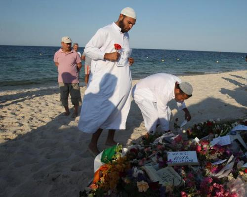 Residents of the coastal town of Sousse in Tunisia place flowers and messages during a gathering at the scene of Friday's shooting attack, Sunday, June 28, 2015. The Friday attack on tourists at a beach is expected to be a huge blow to Tunisia's tourism sector, which made up nearly 15 percent of the country's gross domestic product in 2014. (ANSA/AP Photo/Abdeljalil Bounhar)
